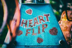Vintage Heart Carnival Ride Sign. Section of Vintage Carnival Ride with hand drawn art saying Heart Flip Stock Photos