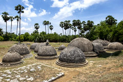 A section of the 20 visible stupas at Kathurugoda Ancient Vihara. A section of the 20 visible stupas at Kathurugoda Ancient Vihara at Chunnakam in the Jaffna royalty free stock photos