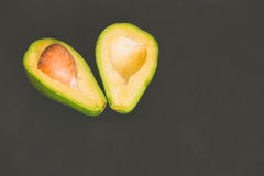 Sectioned avocado / background Royalty Free Stock Photos