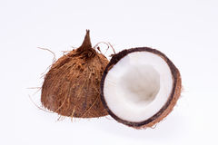 Sectioned coconut isolated on white background close up Stock Images