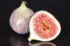 Sectioned fruit figs isolated on black background Royalty Free Stock Photos