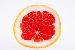 Sectioned fruit of red grapefruit isolated on white background Stock Image