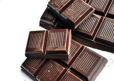Dark Chocolate. Sections of a bar of dark chocolate royalty free stock photos