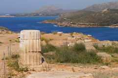 Sections of column of temple of Poseidon on coast of cape Sounio Royalty Free Stock Image