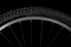 Sector of a bicycle wheel. On a black background Stock Images