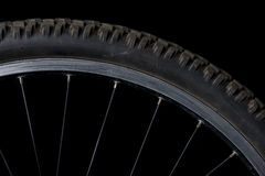 Sector of a bicycle wheel. On a black background Royalty Free Stock Photo