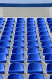 Sector of the stadium with blue armchairs with a place for the l. Place for the inscription on the chairs at the stadium Royalty Free Stock Photo