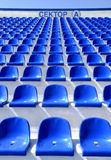 Sector of the stadium with the inscription. The blue empty plastic stadium chairs with the inscription: Sector A Royalty Free Stock Images