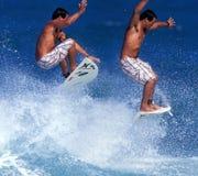 Secuencia del aire de la persona que practica surf Imagen de archivo libre de regalías