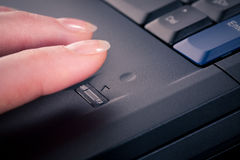 Secure Access. Female accessing a secure computer with a fingerprint reader. Closeup image stock images