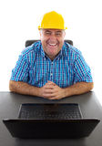 Secure business concept. Businessman with hardhat at his laptop, safe business concept Royalty Free Stock Photography
