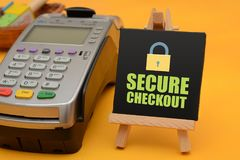 Secure checkout sign with credit card swipe machine.  Stock Photo