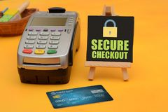 Secure checkout sign with credit card swipe machine.  Stock Photography