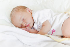 Secure childhood. Cute baby sleeping peacefully in her crib Royalty Free Stock Photography