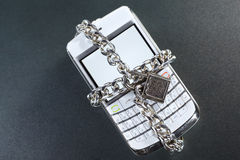Secure communication. Cell phone with locked chain around it for secure communication concept royalty free stock photo
