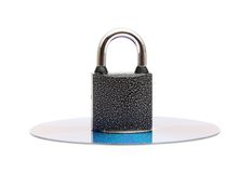 Secure Data: Cd/Dvd Locked By Padlock Royalty Free Stock Photography