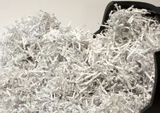 Secure document destruction. A pile of shredded or destroyed business paper Royalty Free Stock Photography