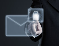 Secure email concept on virtual touch screen. Businessman touching virtual futuristic display with icon for secure email communication royalty free stock photography