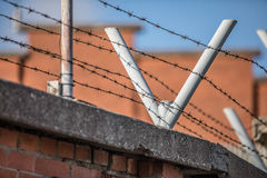 Secure fence. High security jail fence with barbed wire Stock Photo