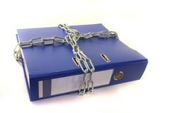 Secure file folders. Closed file folder with a chain on a white background Stock Photo