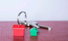 Secure home. Security key with houses on a board with white background Stock Photo