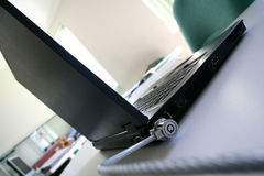 Secure laptop. A laptop secured by a laptop lock Stock Photography