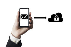 Secure mail cloud. Hand holding smartphone with secure mail to cloud symbol stock photo