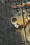 Secure padlock #0. Padlock with chains on the old heavy castle doors royalty free stock photos