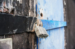 Secure padlock on a building Stock Photos