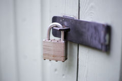Secure padlock on willow garden shed. Padlocked shed, now secure and bolted with blurred background stock image