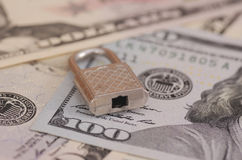 Secure payments. Padlock on United States one hundred-dollar bill Stock Image