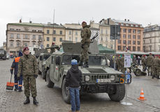 Secure Poland NATO welcome ceremony in Krakow, Poland. Welcome to American troops on Krakow Market Square during picnic Secure Poland dedicated to arriving of royalty free stock photo