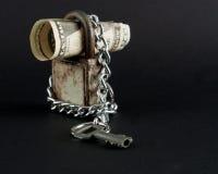 Dollar in padlock Stock Photos