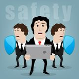 Secure. Two men with shields protect the businessman with the tablet Stock Photo
