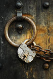Secure wooden doors #4. Heavy wooden doors with chains and padlocks are all about security stock photos