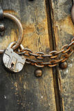 Secure wooden doors #5. Heavy wooden doors with chains and padlocks are all about security stock image