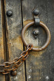 Secure wooden doors #6. Heavy wooden doors with chains and padlocks are all about security royalty free stock photography