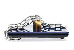 Secure your data. Laptop chained and locked with a locker, securing your data on the laptop Stock Image