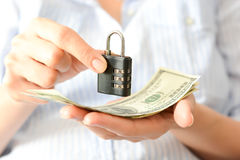 Secure your savings concept with cipher lock and money Royalty Free Stock Photos