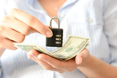 Secure your savings concept with cipher lock and money Stock Photos