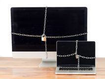 Secured computers with lock Royalty Free Stock Photo