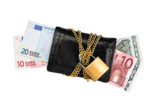 Secured Euro banknotes in wallet. Euro banknotes in a black wallet locked with a golden chain with padlock for security Stock Photo