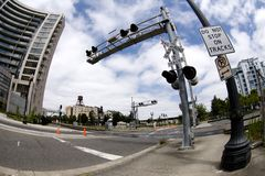 Secured railroad crossing. Urban scenery Stock Images