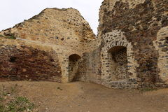 Secured ruins of old castle walls with doors and recess Stock Photo