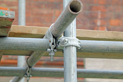 Secured Scaffolding. This photo shows some scaffolding pipes made secure with nuts and bolts royalty free stock images