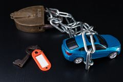 Securing the car against theft. Protection against theft of a passenger car. Dark background stock image