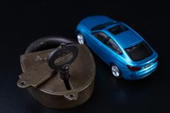 Securing the car against theft. Protection against theft of a passenger car. Dark background stock images