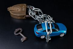 Securing the car against theft. Protection against theft of a passenger car. Dark background royalty free stock photography