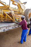 Securing Chain Fastener. Chain strapping to secure the grader for road transport royalty free stock photography