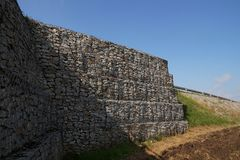Securing the road. A huge retaining wall, designed to stabilize Royalty Free Stock Photography